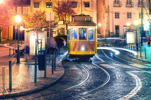 Poster Famous vintage yellow 28 tram of of Alfama, in the oldest district of the Old To