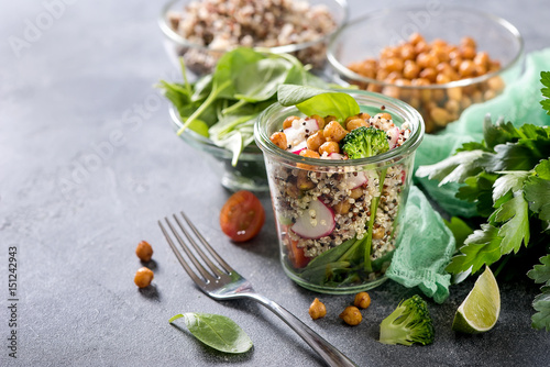 Foto Murales Quinoa salad with chickpeas in mason jar, spinach, veggies, healthy vegan food, dieting, clean eating, vitamin and protein snack