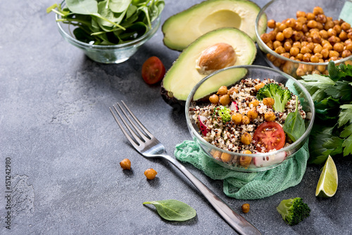 Foto Murales Quinoa salad with chickpeas, spinach, avocado and veggies, healthy vegan food, dieting, clean eating, vitamin and protein snack