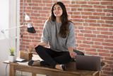 Office Female Worker Meditating On Desk