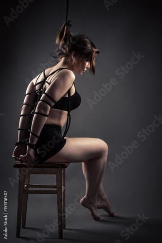 beautiful female slave sitting bondage ropes on chair Poster