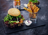 Vegan mushroom burger with salad on a table.
