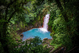 Celestial blue waterfall in volcan tenorio national park costa rica