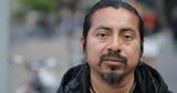Hispanic Latino man in city face portrait - 151509341