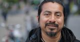 Hispanic Latino man in city face portrait - 151509360
