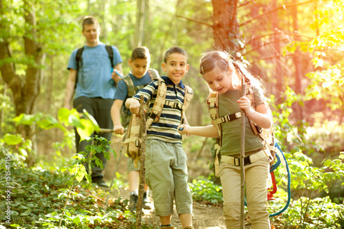 Children scouts and father explore the beautiful forest Poster