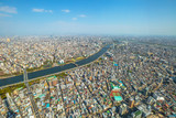 Aerial view of Tokyo city skyline, Sumida River Bridges and Asakusa area from Tokyo Skytree observatory. Daytime. Tokyo, Japan.