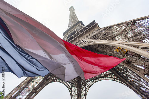 Papiers peints Tour Eiffel Eiffel Tower and French Flag, concept picture about political situation in France and terrorist attack