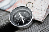Compass and map on a beautiful wooden surface - 151720918