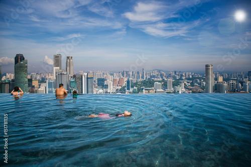 Asian girl swim in swimming pool Poster