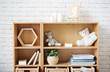 Wooden shelf sgainst white brick wall in empty room