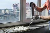 Worker is using a polyurethane foam. - 151806564
