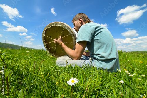 Plagát Man with a tambourine on the grass, Ukraine, May 2017, Ivano-Frankivsk region