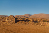 Small hut made of stones on bolivian altiplano