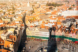 Panorama of Bruges, aka Brugge. View from Belfort tower. Orange rooftops around Market Square, Belgium.