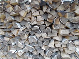 Woodpile of cut Lumber for forestry industry.Woodpile of cut trees in the lumber yard. Grey Background and texture with space for text or image.