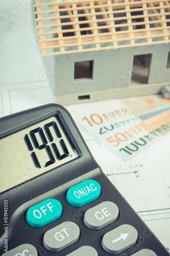 House under construction, calculator and currencies euro on electrical drawings and diagrams - 151943555