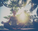A young man doing yoga in nature. Healthy lifestyle, meditation, lifestyle concept