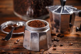 Ground coffee and moka pot