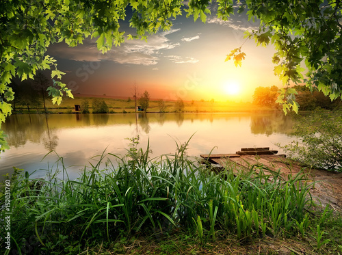 Foto op Canvas Oranje Fishing lake in evening