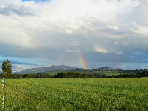 Regenbogen über den Bergen, Allgäu, Bayern