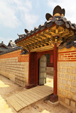 Seoul. Palace Gyeongbokgung. The gate between the palace pavilions, traditionally decorated with a carved roof