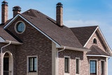 house with a gable roof window - 152086369