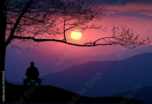 Man meditate under the big tree