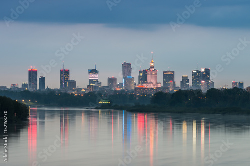 Fototapeta Night panorama of Warsaw skyline, Poland, over Vistula river in the night