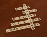 Crossword puzzle with words Rules, Standards, Regulations Codes. Compilance concept.