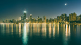 Chicago skyline at night with reflections
