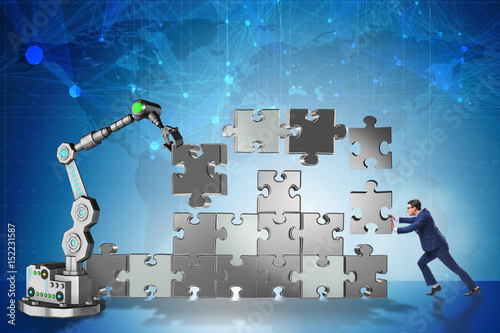 Businessman doing jigsaw puzzle with robotic arm