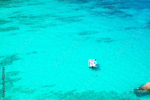 Foto op Aluminium Groene koraal Top Landscape view of white boat in clear blue ocean,summer vacation