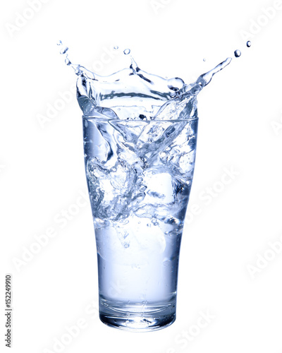 Water splashing out of a glass isolated on white background.