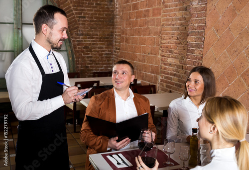 Male waiter writing down order