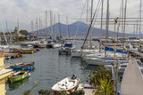 naples tourist harbor and vesuvius on background