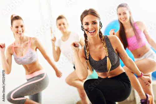 Group of smiling people doing aerobics - 152349711