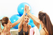 Young women group gicing high five at the gym after workout - 152352774