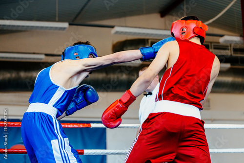 punch head amateur boxer man boxing fight in ring