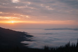 Fog morning in mountains.