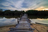 The old wooden bridge over a river at Kg. Pulau Kerengga, Marang Malaysia with sunset scenery