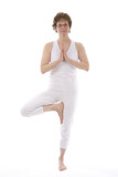 Mature woman practicing yoga exercise.