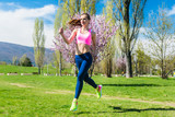 Woman running fast for sport on sunny day