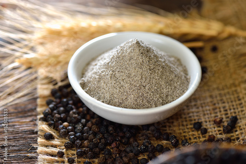 Poster black pepper powder on table