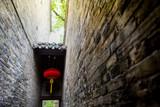 narrow brick wall with Chinese red lamp, ancient wall of China village park
