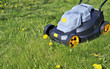 The new electric no name lawn-mower is ready to mow a grass and dandelions - 152597928