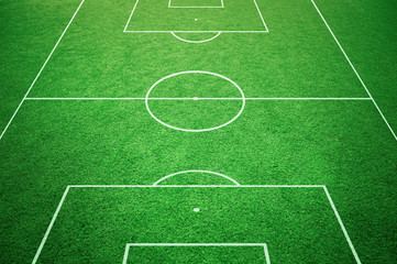 Soccer playfield ground lines on sunny grass background. Goal side perspective used.