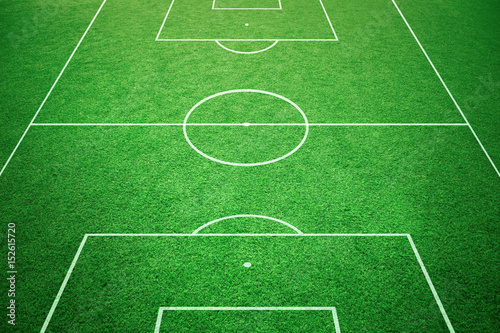 Fototapeta Soccer playfield ground lines on sunny grass background. Goal side perspective used.
