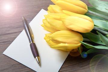 yellow tulips and postcard