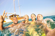 Young multiracial friends taking selfie and swimming on sailing boat sea trip - Rich happy guys and girls having fun in summer party day - Exclusive vacation concept - Bright afternoon  warm filter - 152644764